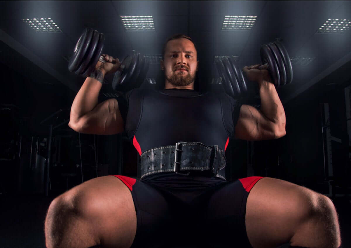 A man doing the Arnold Press.