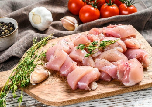 raw chicken on a platter with some seasonings