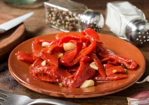 red peppers on a plate with garlic in a restaurant