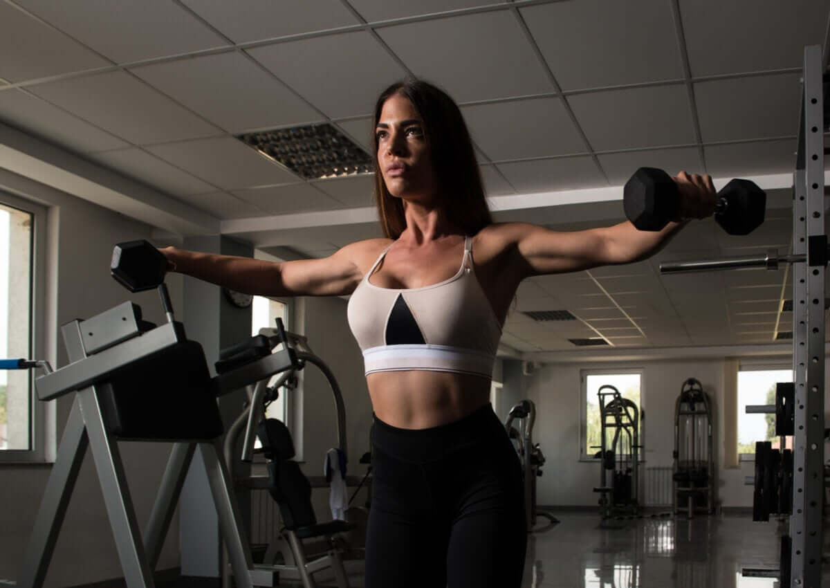 A woman doing lateral raises.