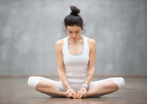 A woman doing the butterfly pose stretch.