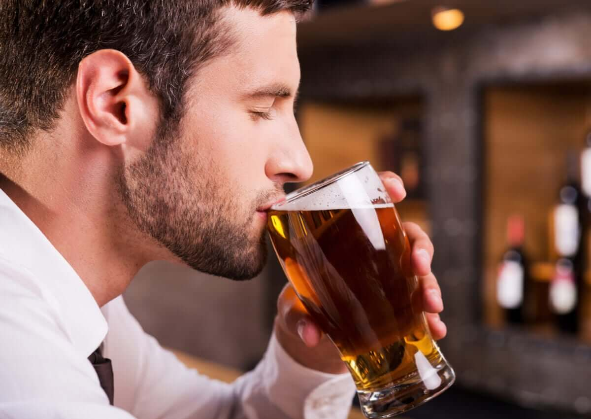 A man drinking a beer.