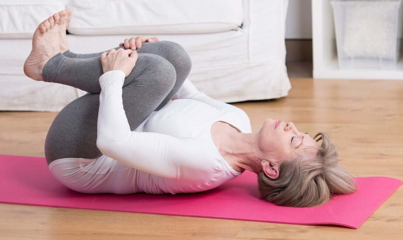 A woman doing yoga for low back pain.