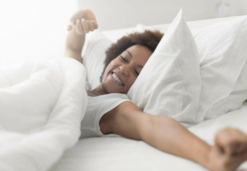 woman snoozing in bed waking up refreshed